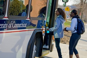 Students board a UConn bus.